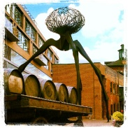 Weird 'War of the Worlds' type sculpture and old barrels in the Distillery District