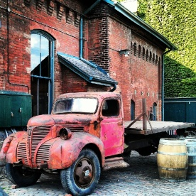 An old beat up truck to the side of Balzac's coffee shop in Toronto's Distillery District