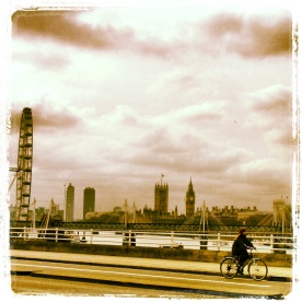 Girl riding her bike along the Waterloo Bridge