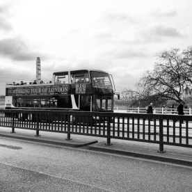 London sightseeing bus going along the Waterloo Bridge