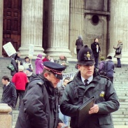 Police standing by during a protest in front of St. Paul's Cathedral