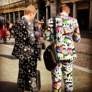 Guys dressed up and walking around Covent Garden. My guess is they're street performers, but maybe they just like crazy suits.