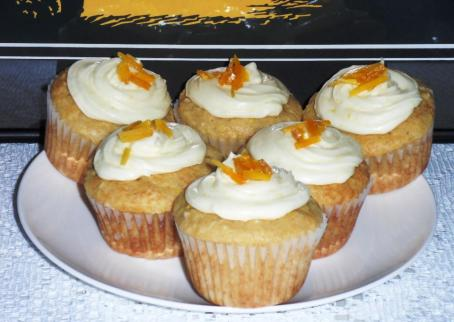 Mango Coconut topped with Mango-Coconut Rum Frosting and Dried Mango