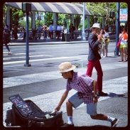A street performing musician and a tipper at in front of the Ferry Building
