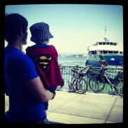 Father and son watching the boats from the Ferry Building