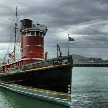 The Hercules docked in Hyde Street Pier with Alcatraz island in the background