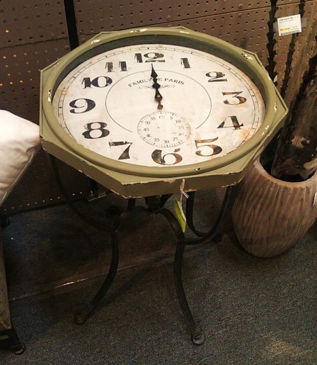 The face of a clock becomes the top of a table.