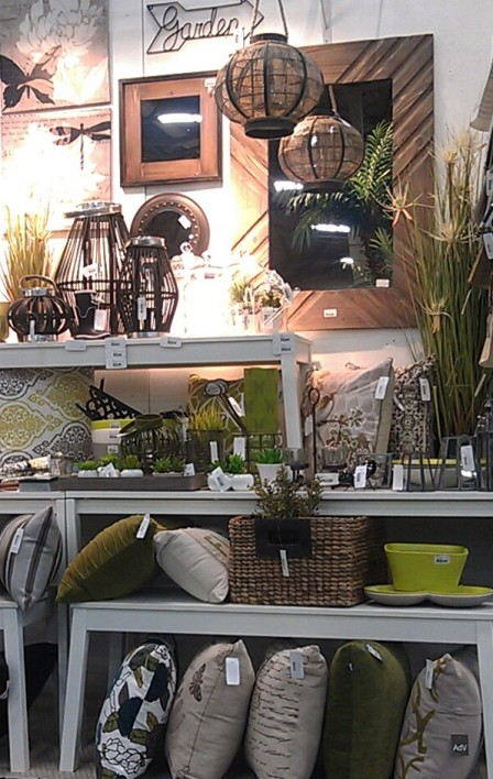 A mix of home accessories that incorporate green and grey.