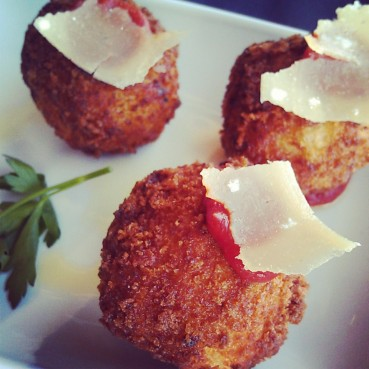 A close-up photo of the Crispy Fried Truffled Mac & Cheese Balls.