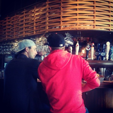Diners sitting at the bar during a busy Saturday morning.
