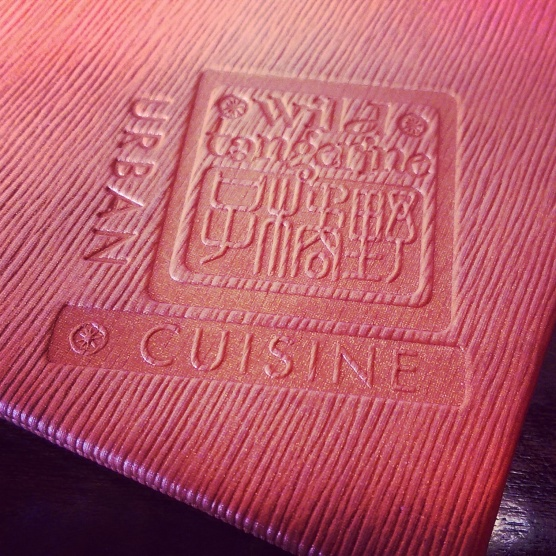 The restaurant's logo on the cover of their menu.
