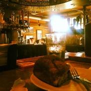 Enjoying my cinnamon bun at a bar seat during a busy morning in October 2013.