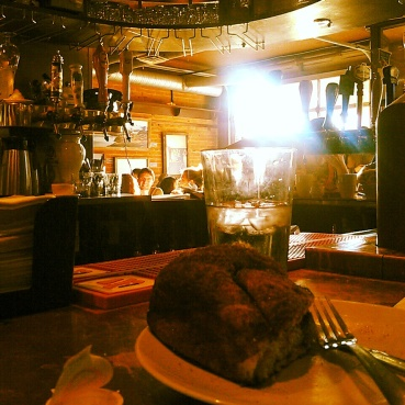 Enjoying my cinnamon bun at a bar seat during a busy morning in October 2013.