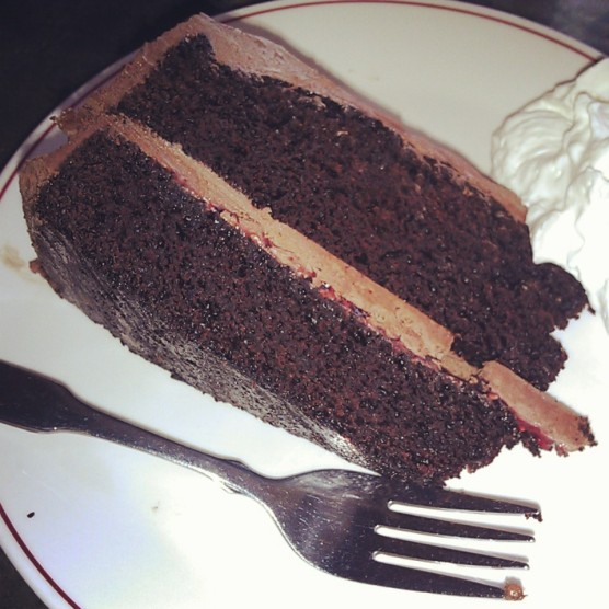 A slice of chocolate raspberry cake.