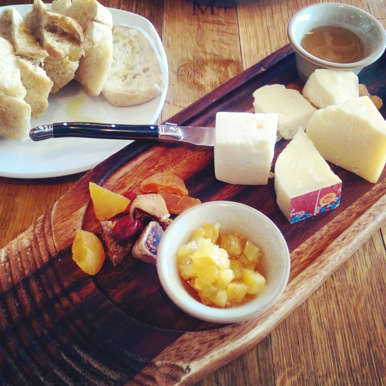 The assorted cheese board.