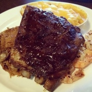 The St. Louis ribs, pulled pork, a shrimp skewer and mac & cheese