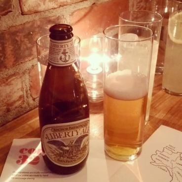 Craft beer and glasses of sparkling lemonade.