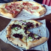 Our pizzas - Truffle on top and Short Rib on the bottom. So good!