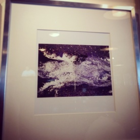 A close-up of one of the framed photographs for sale at The Next Act.