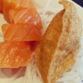Inari sushi and thick pieces of salmon sashimi at Watari.