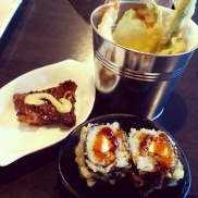 The golden Alberta maki rolls with beef short rib and a basket of tempura at Watari.
