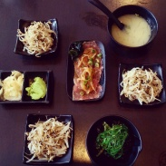 Miso soup, bean sprout and seaweed salads and beef tataki at Watari.