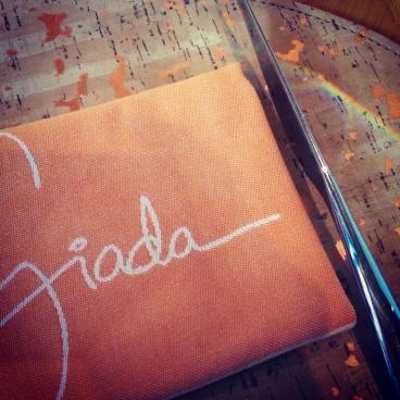 The Giada place settings with a rainbow.
