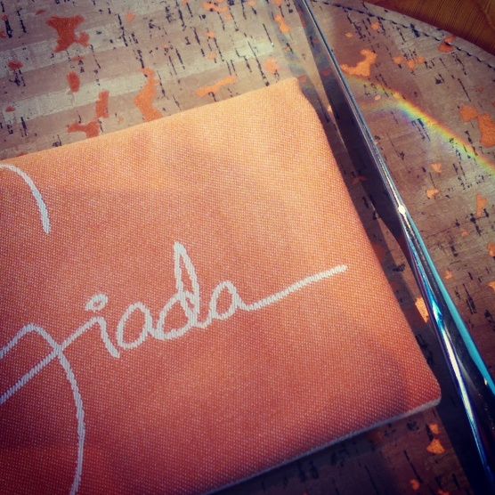 The Giada place settings with a rainbow.