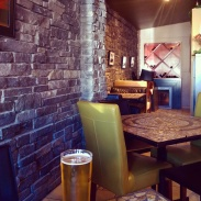 Brick walls and mosaic tables give this place a chalet-like feel.