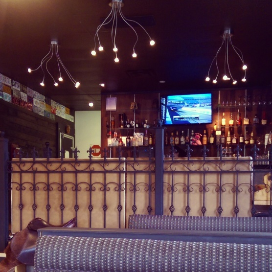 The bar and the large booths at Sloppy Hoggs. It definitely has a country feel.