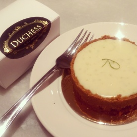 The scrumptious key lime tart with my friend's simply sealed to go box of macarons.