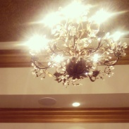 Vintage chandeliers decorate the ceilings.