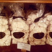 Large bags of pre-packaged dark chocolate meringues at the shop.