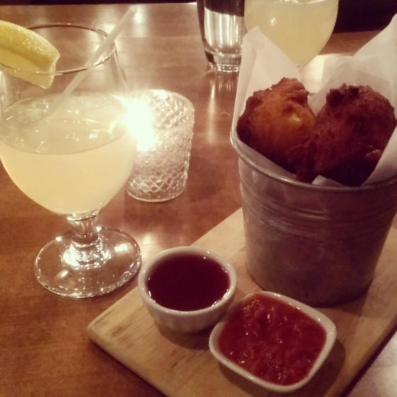 Corn fritters to share and glasses of lemonade.