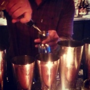 Simon making cocktails