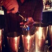 Simon making cocktails