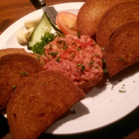 The excellent and rich steak tartar with garlic and fried bread.