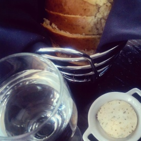Fresh bread and herbed butter to start.