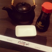 Necessities of the Japanese meal...chopsticks, soy sauce, a sauce dish and tea.