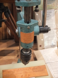 A leather embosser at Log-On
