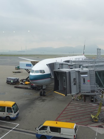 Watching our plane being unloaded and cleaned before boarding