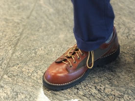 Sitting across from a man at the Changi Airport. I liked his shoes.