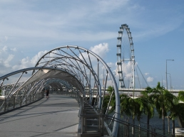 A bridge and the Singapore Flyer