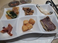 Back in Hong Kong at another meal with several courses. These were just the appetizers.