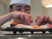 The sushi chef creating a combination plate
