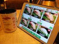 A digital menu at Itacho Sushi.