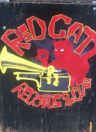 The Red Cat Records sign on Main Street.