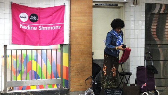 A subway performer packing up her things