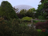 The Bloedel Conservatory peeks through above the landscaping in QE Park as we cross the bridge.