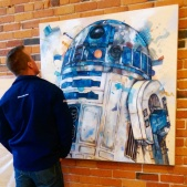 Taking in the details of the R2-D2 painting by Jon Shaw.